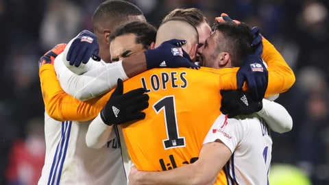 <p>               Lyon players celebrate their 2-1 win after the French League One soccer match between Lyon and Paris Saint-Germain in Decines, near Lyon, central France, Sunday, Feb. 3, 2019. (AP Photo/Laurent Cipriani)             </p>