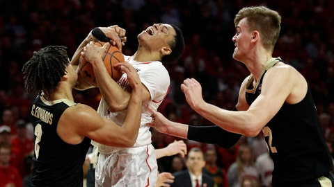 <p>               Maryland guard Anthony Cowan Jr., center, tries for a shot between Purdue guard Carsen Edwards, left, and center Matt Haarms during the second half of an NCAA college basketball game Tuesday, Feb. 12, 2019, in College Park, Md. Maryland won 70-56. (AP Photo/Patrick Semansky)             </p>
