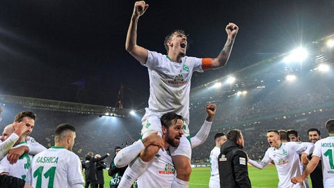 <p>               Bremen's Max Kruse, up, celebrates on the shoulders of Bremen's Martin Harnik after winning the German soccer cup, DFB Pokal, match between Borussia Dortmund and Werder Bremen in Dortmund, Germany, Tuesday, Feb. 5, 2019. Dortmund was defeated by Bremen with 5-7 after penalty shootout. (AP Photo/Martin Meissner)             </p>