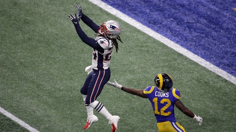 <p>               New England Patriots' Stephon Gilmore (24) prepares to intercept the ball against Los Angeles Rams' Brandin Cooks (12) during the second half of the NFL Super Bowl 53 football game Sunday, Feb. 3, 2019, in Atlanta. (AP Photo/Charlie Riedel)             </p>
