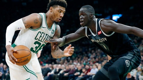 <p>               Boston Celtics' Marcus Smart, left, drives for the basket against Detroit Pistons' Thon Maker, right, during the first half of an NBA basketball game in Boston, Wednesday, Feb. 13, 2019. (AP Photo/Michael Dwyer)             </p>