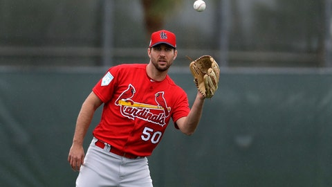 <p>               St. Louis Cardinals pitcher Adam Wainwright catches a ball during spring training baseball practice Wednesday, Feb. 13, 2019, in Jupiter, Fla. (AP Photo/Jeff Roberson)             </p>