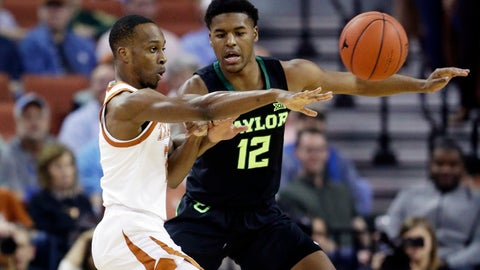 <p>               Texas guard Courtney Ramey (3) passes the ball past Baylor guard Jared Butler (12) during the first half on an NCAA college basketball game Wednesday, Feb. 6, 2019, in Austin, Texas. (AP Photo/Eric Gay)             </p>