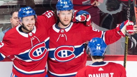 <p>               Montreal Canadiens' Jonathan Drouin, center, celebrates with teammates Victor Mete (53) and Phillip Danault after scoring against the Edmonton Oilers during overtime NHL hockey game action in Montreal, Sunday, Feb. 3, 2019. (Graham Hughes/The Canadian Press via AP)             </p>
