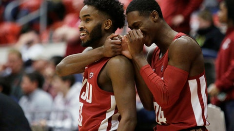 <p>               Washington State guard Ahmed Ali, left, and guard Viont'e Daniels celebrate during the second half of the team's NCAA college basketball game against Colorado in Pullman, Wash., Wednesday, Feb. 20, 2019. Washington State won 76-74. (AP Photo/Young Kwak)             </p>