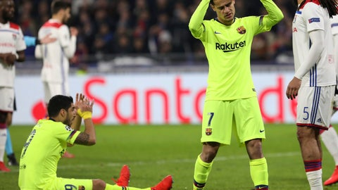 <p>               Barcelona forward Luis Suarez, left, and Barcelona forward Philippe Coutinho, right, react during the Champions League round of 16 first leg soccer match between Lyon and FC Barcelona in Decines, near Lyon, central France, Tuesday, Feb. 19, 2019. (AP Photo/Laurent Cipriani)             </p>