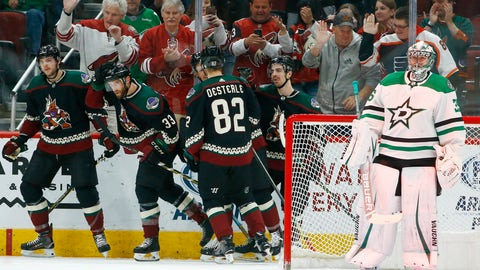 <p>               Arizona Coyotes defenseman Alex Goligoski (33) celebrates his goal against Dallas Stars goaltender Anton Khudobin, right, with Coyotes center Alex Galchenyuk, left, defenseman Jordan Oesterle (82), center Nick Cousins, third from right, and right wing Conor Garland, second from right, during the first period of an NHL hockey game Saturday, Feb. 9, 2019, in Glendale, Ariz. (AP Photo/Ross D. Franklin)             </p>