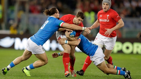 <p>               Wales' Jake Ball, center, is tackled by Italy's Michele Campagnaro, left, and Italy's Guglielmo Palazzani during the Six Nations rugby union international between Italy and Wales, at Rome's Olympic Stadium, Saturday, Feb. 9, 2019. (AP Photo/Andrew Medichini)             </p>