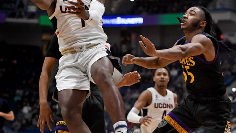 <p>               Connecticut's Christian Vital (1) shoots as East Carolina's Shawn Williams (55) defends during the first half of an NCAA college basketball game, Sunday, Feb. 3, 2019, in Hartford, Conn. (AP Photo/Jessica Hill)             </p>