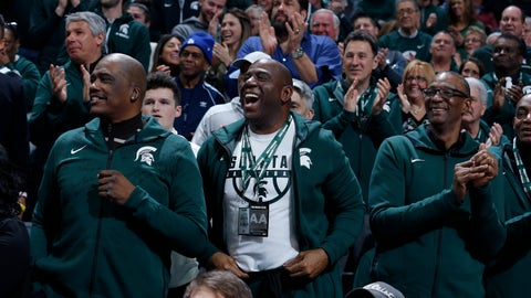 <p>               Former players on Michigan State's 1979 national championship team, including Magic Johnson, center, Jay Vincent, left, and Greg Kelser, right, react during the first half of an NCAA college basketball game against Minnesota, Saturday, Feb. 9, 2019, in East Lansing, Mich. (AP Photo/Al Goldis)             </p>