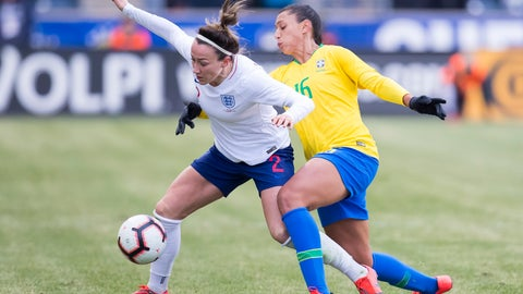 <p>               England's Lucy Bronze, left, goes after the ball while keeping Brazil's Beatriz, right, away during the first half of She Believes Cup soccer match, Wednesday, Feb. 27, 2019, in Chester, Pa. (AP Photo/Chris Szagola)             </p>