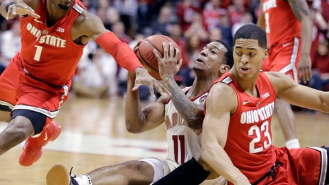 <p>               Indiana's Devonte Green (11) controls the ball against Ohio State's Luther Muhammad (1) and Jaedon LeDee (23) during the first half of an NCAA college basketball game, Sunday, Feb. 10, 2019, in Bloomington, Ind. (AP Photo/Darron Cummings)             </p>