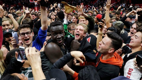 <p>               San Diego State forward Aguek Arop, center left, is swarmed by fans after San Diego State defeated Nevada 65-57 in an NCAA college basketball game Wednesday, Feb. 20, 2019, in San Diego. (AP Photo/Gregory Bull)             </p>