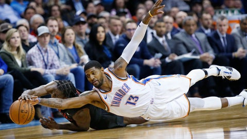 <p>               Oklahoma City Thunder forward Paul George (13) dives for the ball with Portland Trail Blazers forward Al-Farouq Aminu, left, in the second half of an NBA basketball game in Oklahoma City, Monday, Feb. 11, 2019. (AP Photo/Sue Ogrocki)             </p>