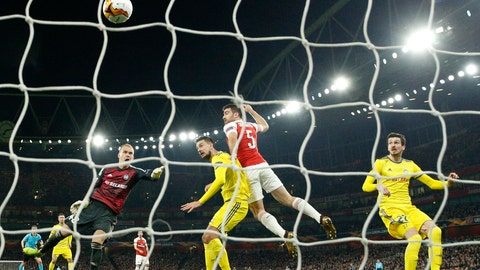 <p>               Arsenal's Sokratis Papastathopoulos, second right, scores his side's third goal during the Europa League round of 32 second leg soccer match between Arsenal and Bate at the Emirates stadium in London, Thursday, Feb. 21, 2019. (AP Photo/Matt Dunham)             </p>