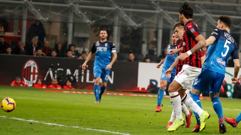 <p>               AC Milan's Krzysztof Piatek, third from right, scores his side's opening goal during the Serie A soccer match between AC Milan and Empoli at the San Siro stadium, in Milan, Italy, Friday, Feb. 22, 2019. (AP Photo/Antonio Calanni)             </p>