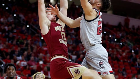<p>               North Carolina State's Devon Daniels (24) shoots as Boston College's Luka Kraljevic (13) defends during the first half of an NCAA college basketball game in Raleigh, N.C., Wednesday, Feb. 20, 2019. (Ethan Hyman/The News & Observer via AP)             </p>
