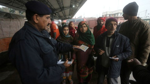 <p>               A Pakistani police officer checks documents of passengers travel to India via Samjhota Express at Lahore railway station in Pakistan, Thursday, Feb. 21, 2019.  Indian authorities suspended a bus service this week without explanation. The development comes amid escalated tensions between Pakistan and India in the wake of last week's deadly suicide bombing in Kashmir against Indian paramilitary troops. (AP Photo/K.M. Chaudary)             </p>