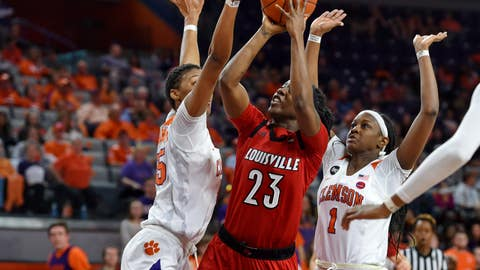<p>               Louisville's Jazmine Jones (23) shoots while pressured by Clemson's Tylar Bennett, left, and Destiny Thomas during the first half of an NCAA college basketball game Saturday, Feb. 2, 2019, in Clemson, S.C. (AP Photo/Richard Shiro)             </p>