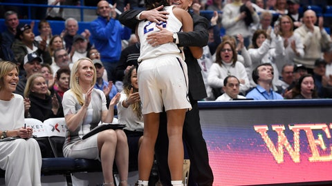 <p>               Connecticut head coach Geno Auriemma embraces Connecticut's Napheesa Collier after Collier comes out of the game during the second half of an NCAA college basketball game against South Carolina, Monday, Feb. 11, 2019, in Hartford, Conn. (AP Photo/Jessica Hill)             </p>
