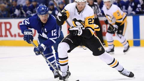 <p>               Toronto Maple Leafs center Patrick Marleau (12) and Pittsburgh Penguins center Nick Bjugstad (27) battle for the puck during the third period of an NHL hockey game, Saturday, Feb. 2, 2019 in Toronto. (Nathan Denette/The Canadian Press via AP)             </p>
