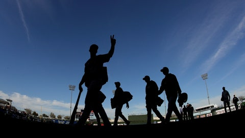 <p>               Colorado Rockies players walk off the field after a spring training baseball game against the Kansas City Royals Monday, Feb. 25, 2019, in Surprise, Ariz. (AP Photo/Charlie Riedel)             </p>