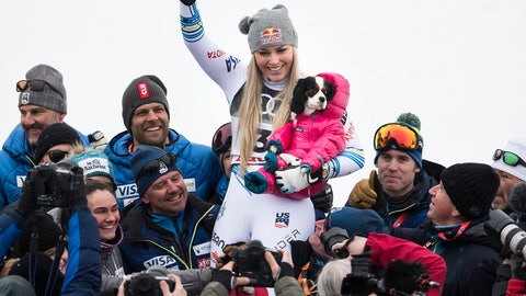 <p>               Lindsey Vonn of the United States celebrates with the dog Lucy after the flower ceremony of the women downhill race at the 2019 FIS Alpine Skiing World Championships in Are, Sweden Sunday, Feb. 10, 2019. (Jean-Christophe Bott/Keystone via AP)             </p>