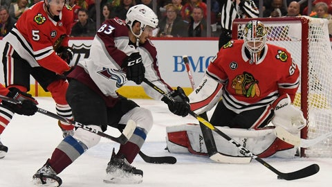 <p>               Colorado Avalanche left wing Matt Nieto (83) skates in on Chicago Blackhawks goaltender Collin Delia (60) as defenseman Connor Murphy (5) defends during the first period of an NHL hockey game Friday, Feb. 22, 2019, in Chicago. (AP Photo/David Banks)             </p>