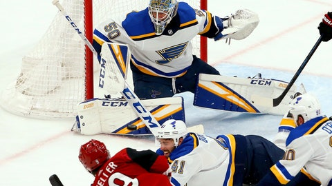 <p>               St. Louis Blues goaltender Jordan Binnington (50) makes a save on a shot by Arizona Coyotes center Clayton Keller (9) as Blues defenseman Robert Bortuzzo (41) and center Ryan O'Reilly (90) try to block the shot during the second period of an NHL hockey game Thursday, Feb. 14, 2019, in Glendale, Ariz. (AP Photo/Ross D. Franklin)             </p>