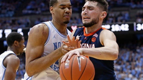 <p>               North Carolina's Garrison Brooks, left, guards Virginia's Ty Jerome, right, during the second half of an NCAA college basketball game in Chapel Hill, N.C., Monday, Feb. 11, 2019. Virginia won 69-61. (AP Photo/Gerry Broome)             </p>