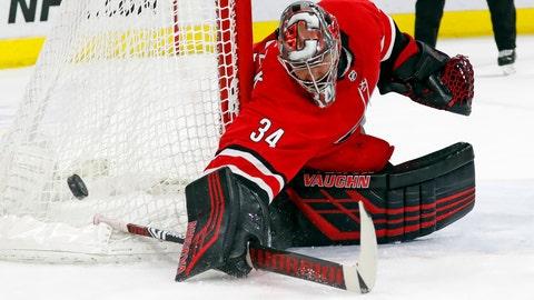 <p>               Carolina Hurricanes goaltender Petr Mrazek (34) blocks a shot of the Dallas Stars during the second period of an NHL hockey game, Saturday, Feb. 16, 2019, in Raleigh, N.C. (AP Photo/Karl B DeBlaker)             </p>