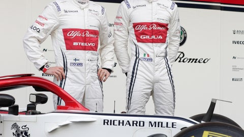 <p>               Drivers Kimi Raikkonen of Finland, left, and Antonio Giovinazzi of Italy, right, pose for photos with the new Alfa Romeo F1 car during a presentation of the new livery at the Barcelona Catalunya racetrack in Montmelo, outside Barcelona, Spain, Monday, Feb.18, 2019. (AP Photo/Manu Fernandez)             </p>
