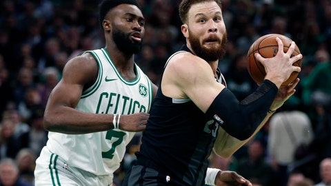 """<p>               File-This Feb. 13, 2019, file photo shows Boston Celtics' Jaylen Brown (7) defending against Detroit Pistons' Blake Griffin (23) during the second half of an NBA basketball game in Boston. A year after arriving in Detroit with his career at a crossroads, a more earthbound Griffin is doing all he can to shake the Pistons out of their decade-long malaise. """"He does a little bit of everything for us. Probably one of our better pick-and-roll players, passers, scorers, leader by example, just so many things,"""" Detroit coach Dwane Casey said. """"His basketball intellect, for me, is one that's been the most impressive of our players. I didn't know that about Blake, because when you think about him, you think about the high-flying dunker and the muscular guy in the post, but there's a lot more to that than just his dunking and athleticism.""""  (AP Photo/Michael Dwyer, File)             </p>"""