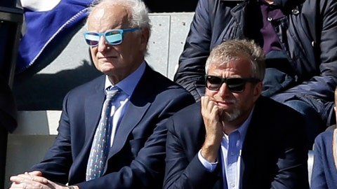 <p>               FILE - In this Sunday, April 12, 2015 file photo, Chelsea's Russian owner Roman Abramovich, right, and Chelsea chairman Bruce Buck, left, watch during the second half of the English Premier League soccer match between QPR and Chelsea at Loftus Road stadium in London. Gathered with his Chelsea's directors, Roman Abramovich stopped the football talk to raise deep concerns he wanted them to address at the club and beyond. (AP Photo/Matt Dunham, File)             </p>