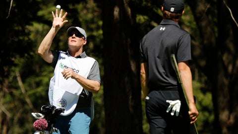 <p>               Shawn Spieth catches a ball thrown by his son Jordan Spieth during the first day of competition of the WGC-Mexico Championship at the Chapultepec Golf Club in Mexico City, Thursday, Feb. 21, 2019. Spieth's father caddied nine holes of practice Wednesday and will be on the bag the rest of the week after Spieth's caddie left because of the death of his father. (AP Photo/Marco Ugarte)             </p>