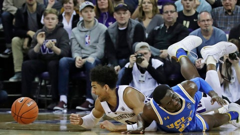 <p>               Washington guard Matisse Thybulle, left, reacts after battling with UCLA guard Prince Ali, right, for a loose ball during the second half of an NCAA college basketball game Saturday, Feb. 2, 2019, in Seattle. Washington won 69-55. (AP Photo/Ted S. Warren)             </p>