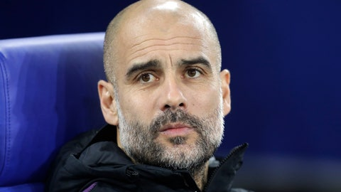 <p>               Manchester City coach Pep Guardiola takes his seat prior to the first leg, round of sixteen, Champions League soccer match between Schalke 04 and Manchester City at Veltins Arena in Gelsenkirchen, Germany, Wednesday Feb. 20, 2019. (AP Photo/Michael Probst)             </p>