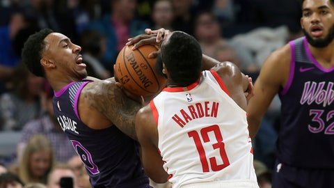 <p>               Houston Rockets' James Harden (13) and Minnesota Timberwolves' Jeff Teague battle for the ball as Timberwolves' Karl-Anthony Towns (32) looks on in the first half of an NBA basketball game, Wednesday, Feb. 13, 2019, in Minneapolis. (AP Photo/Jim Mone)             </p>
