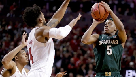 <p>               FILE - In this Jan. 17, 2019, file photo, Michigan State's Cassius Winston (5) shoots against Nebraska's James Palmer Jr. and Isaac Copeland Jr. (14) during the second half of an NCAA college basketball game in Lincoln, Neb. Winston has developed into a player of the year candidate, leading No. 6 Michigan State as it contends for a Big Ten title and perhaps top seeding in the NCAA tournament while two of its top players are injured. (AP Photo/Nati Harnik, File)             </p>