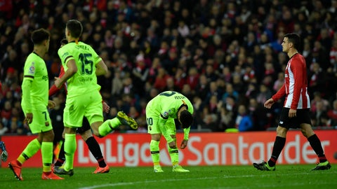<p>               FC Barcelona's Lionel Messi, center, reacts during the Spanish La Liga soccer match between Athletic Bilbao and FC Barcelona at San Mames stadium, in Bilbao, northern Spain, Sunday, Feb. 10, 2019.(AP Photo/Alvaro Barrientos)             </p>