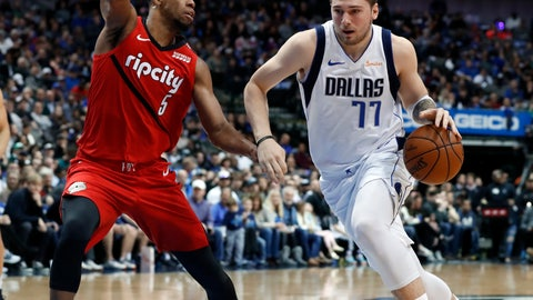 <p>               Portland Trail Blazers' Rodney Hood (5) defends as Dallas Mavericks forward Luka Doncic (77) drives to the basket for a shot in the first half of an NBA basketball game in Dallas, Sunday, Feb. 10, 2019. (AP Photo/Tony Gutierrez)             </p>