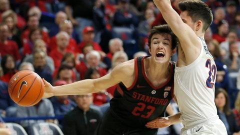 <p>               Stanford guard Cormac Ryan (23) drives on Arizona guard Alex Barcello in the first half during an NCAA college basketball game, Sunday, Feb. 24, 2019, in Tucson, Ariz. (AP Photo/Rick Scuteri)             </p>