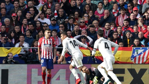 <p>               Real Madrid's Casemiro, centre, celebrates after scoring his sides 1st goal during a Spanish La Liga soccer match between Atletico Madrid and Real Madrid at the Metropolitano stadium in Madrid, Spain, Saturday, Feb. 9, 2019. (AP Photo/Manu Fernandez)             </p>