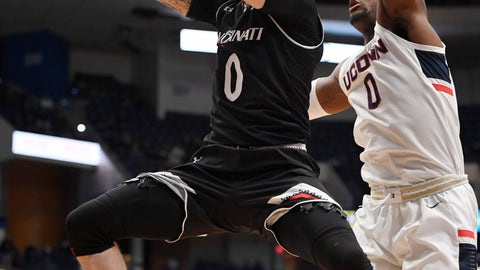 <p>               Cincinnati's Logan Johnson makes a basket as Connecticut's Eric Cobb (0) defends during the first half of an NCAA college basketball game, Sunday, Feb. 24, 2019, in Hartford, Conn. (AP Photo/Jessica Hill)             </p>