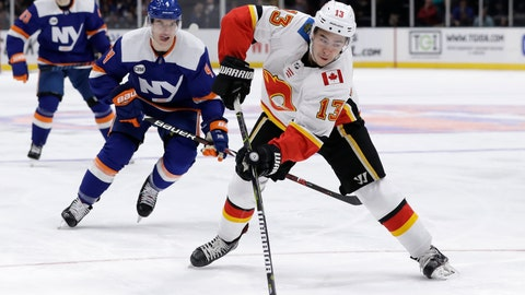 <p>               Calgary Flames left wing Johnny Gaudreau (13) looks for a shot with New York Islanders defenseman Thomas Hickey (4) keeping an eye on him in the first period of an NHL hockey game, Tuesday, Feb. 26, 2019, in Uniondale, N.Y. (AP Photo/Kathy Willens)             </p>