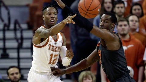 <p>               Texas guard Kerwin Roach II, left, passes the ball around Oklahoma State forward Cameron McGriff during the first half of an NCAA college basketball game, Saturday, Feb. 16, 2019, in Austin, Texas. (AP Photo/Eric Gay)             </p>