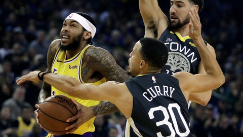<p>               Los Angeles Lakers' Brandon Ingram, left, drives the ball past Golden State Warriors' Stephen Curry (30) and Klay Thompson in the first half of an NBA basketball game Saturday, Feb. 2, 2019, in Oakland, Calif. (AP Photo/Ben Margot)             </p>