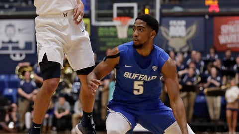 <p>               Buffalo's CJ Massinburg (5) drives by Akron's Tyler Cheese (4) in the first half of an NCAA college basketball game, Tuesday, Feb. 12, 2019, in Akron, Ohio. (AP Photo/Tony Dejak)             </p>