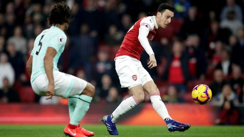 <p>               Arsenal's Mesut Ozil, right, scores his side's first goal of the game against Bournemouth during their English Premier League soccer match at the Emirates Stadium in London, Wednesday Feb. 27, 2019. (Adam Davy/PA via AP)             </p>