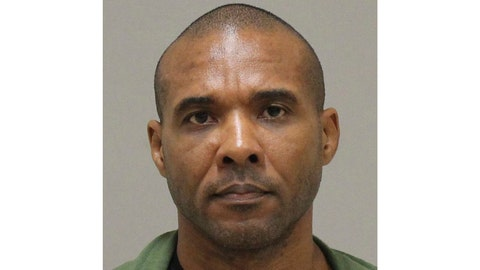 """<p>               In this photo provided by the Kent County Michigan Sheriff's office, Cedric Marks is pictured in a booking photo in Grand Rapids, Mich., dated Jan. 8, 2019. The Montgomery County Texas Sheriff's Office say Marks, facing three """"pending murder charges"""", has escaped from a private prisoner transport in Conroe, Texas, and is considered """"extremely dangerous."""" (Kent County Michigan Sheriff's Office via AP)             </p>"""